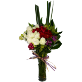 Red and White Roses arrange in a clear Glass Vase